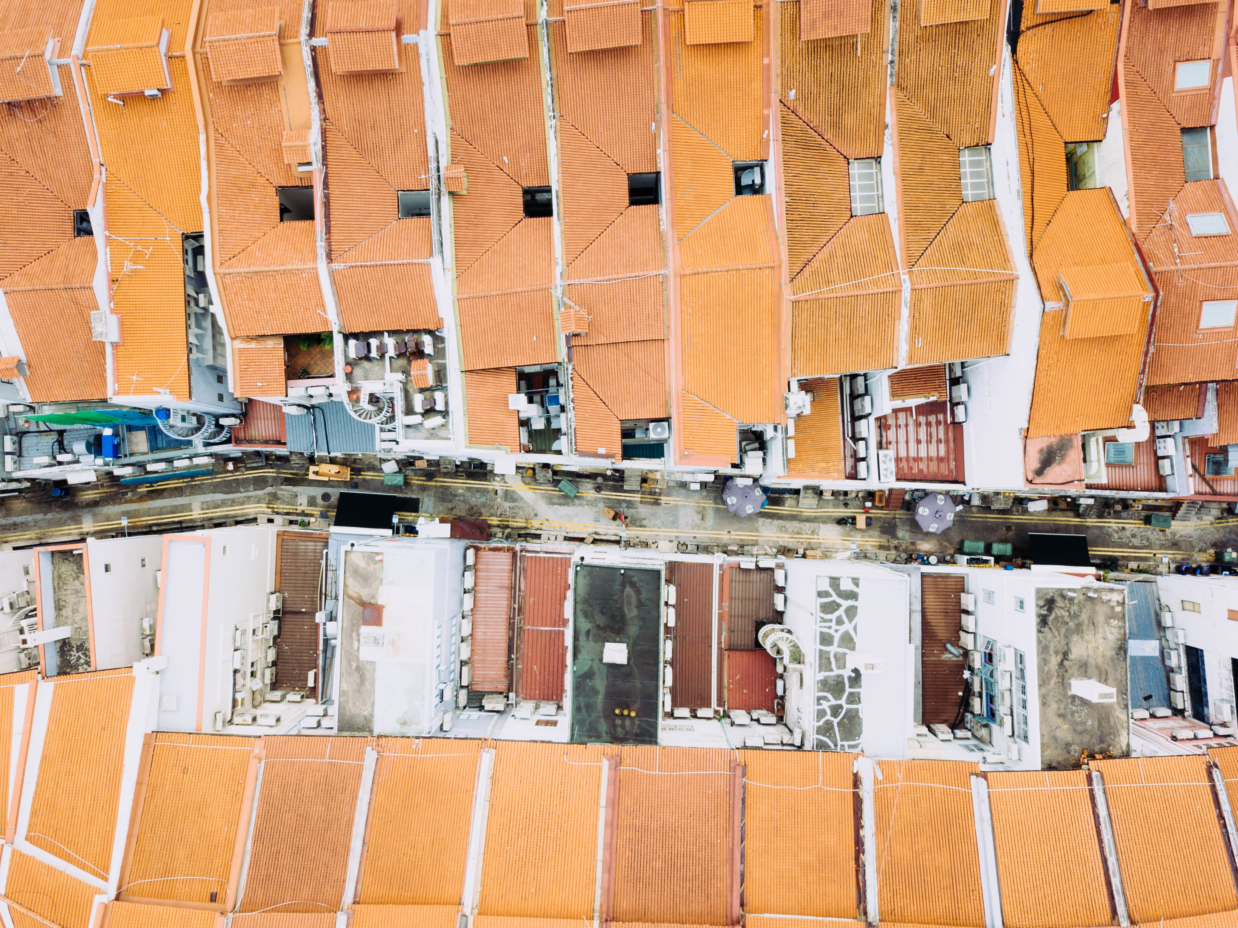 aerial photography of assorted-color house roofs at daytime