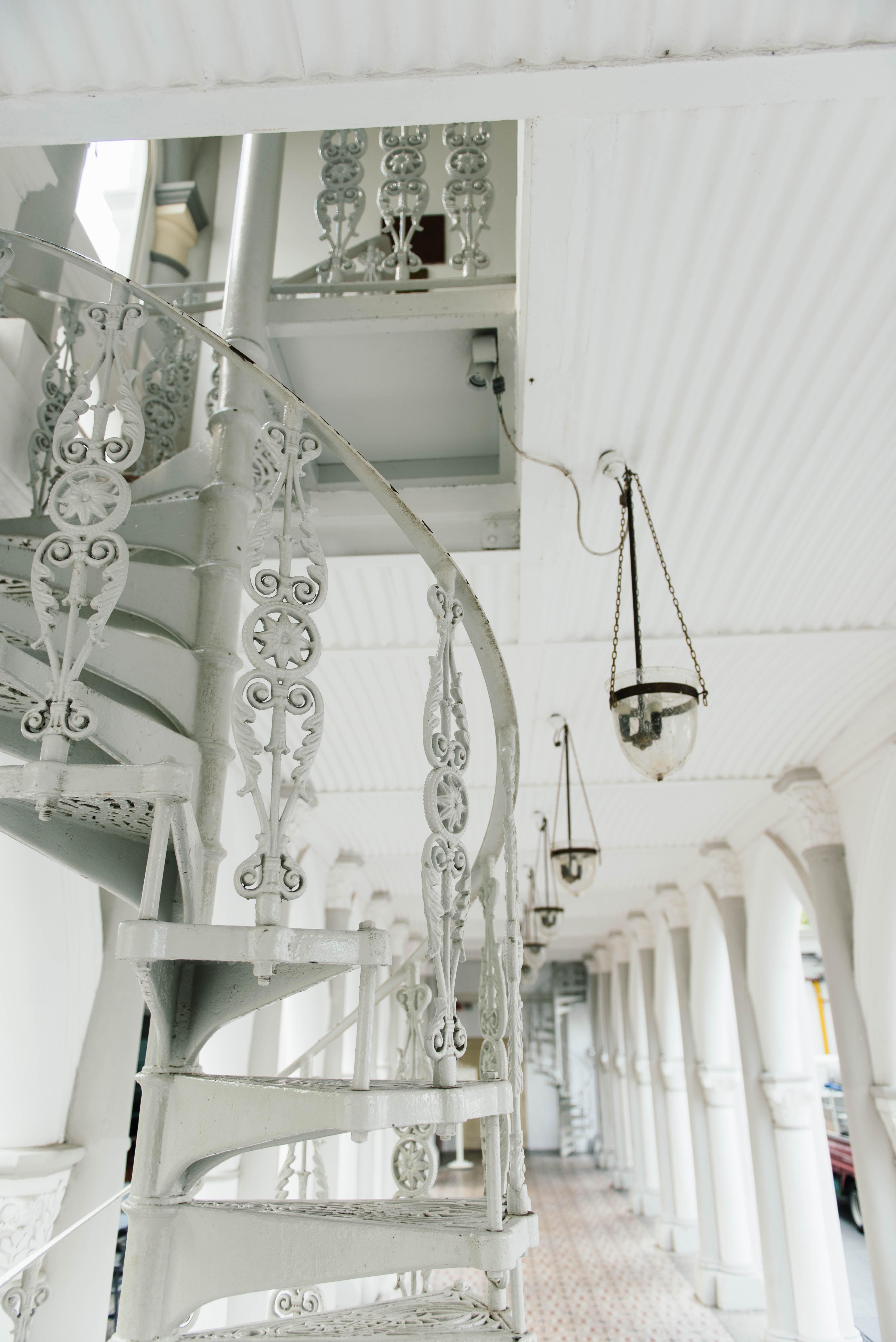 white spiral stairs near pendant lamp