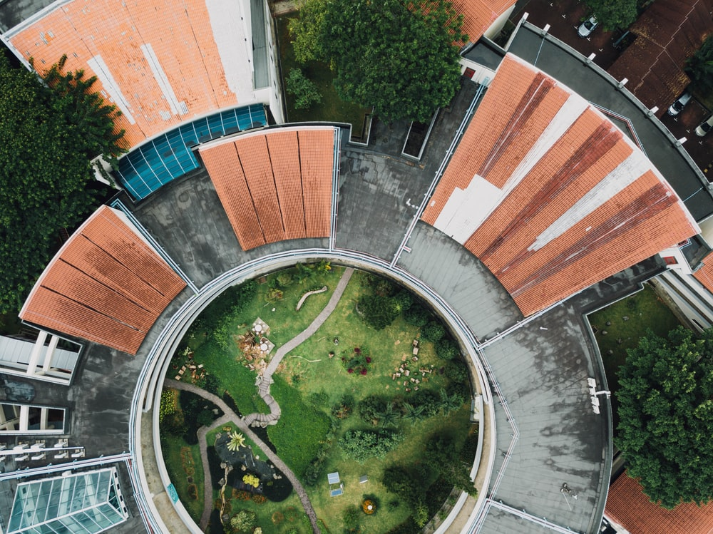 aerial photo of round garden and building