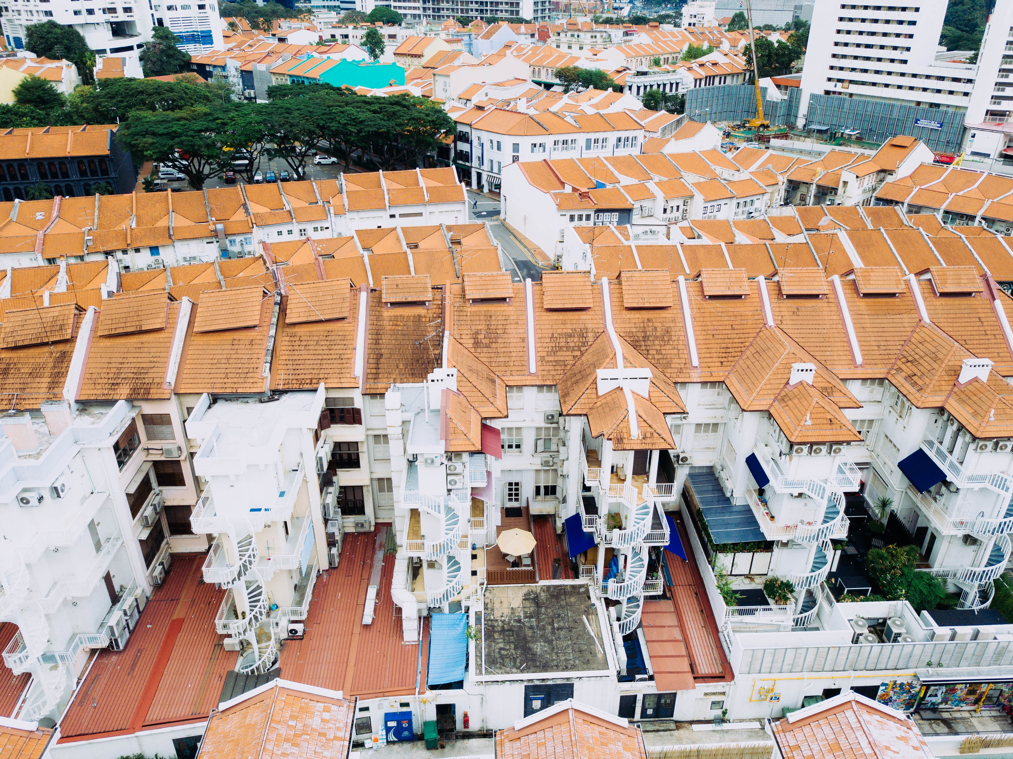 aerial photo of houses with brown roofs