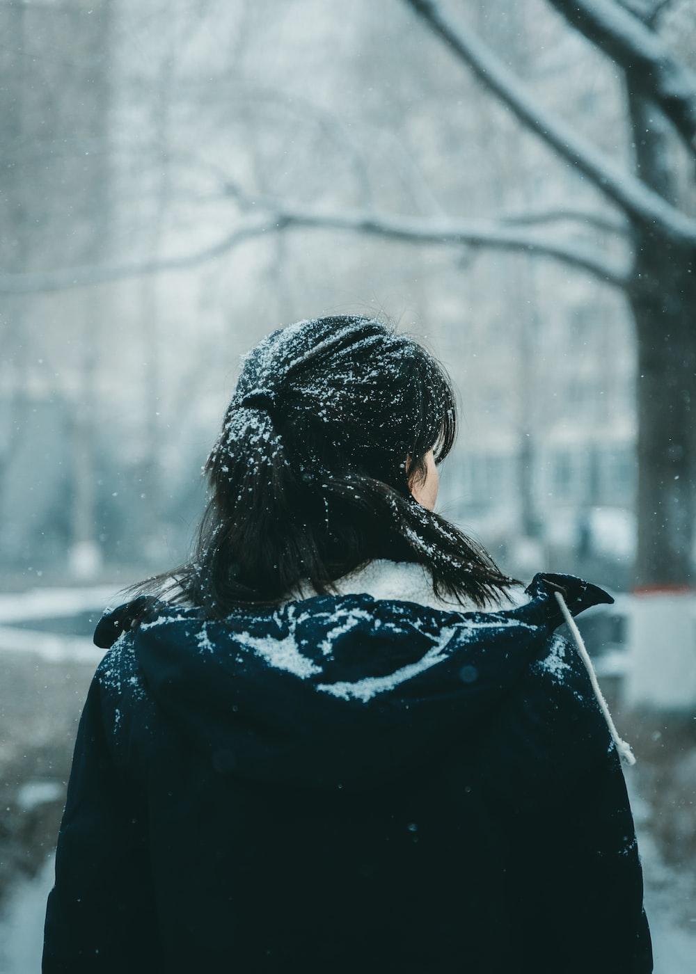 woman wearing black coat