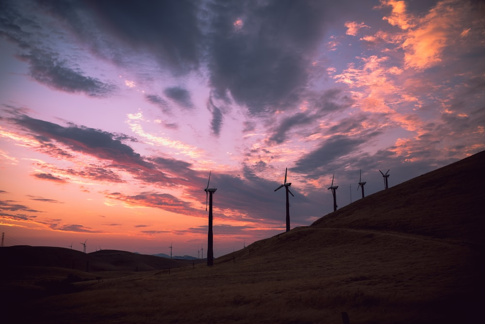 wind turbines under clear blue sky