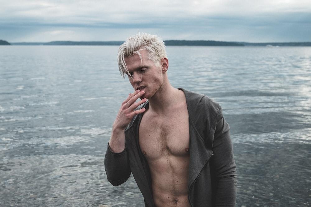 man wearing black top near body of water