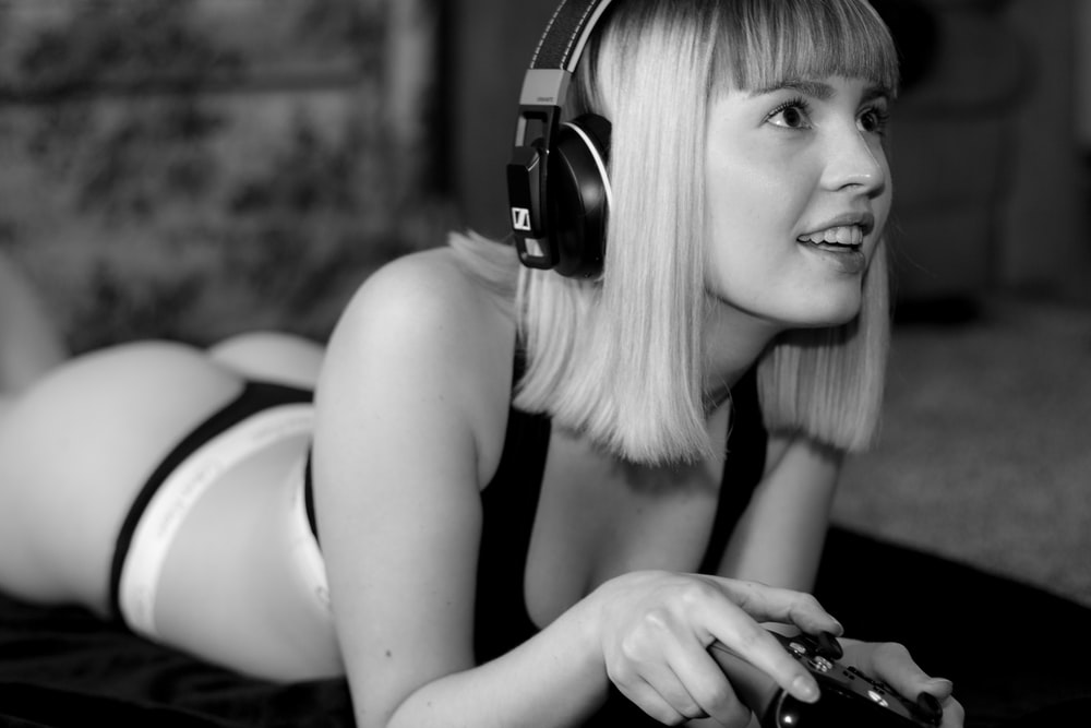 grayscale photography of woman playing video game