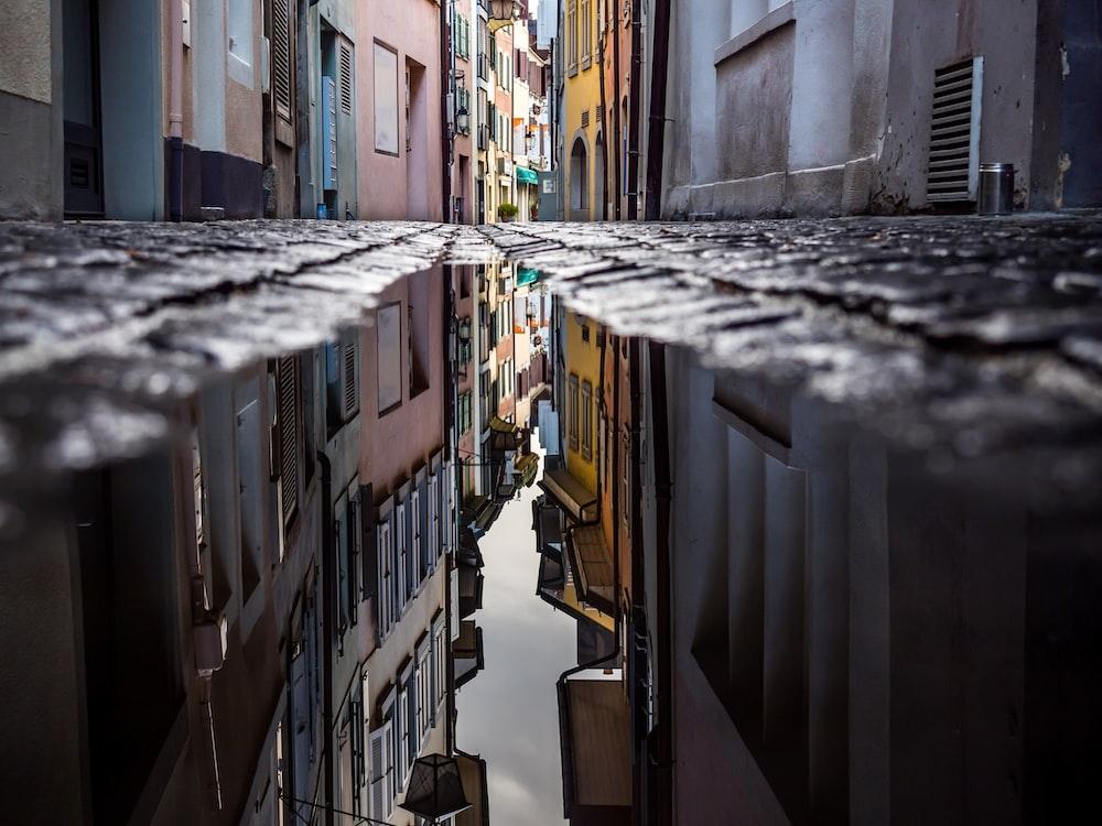 worm's eye view of pathway between houses