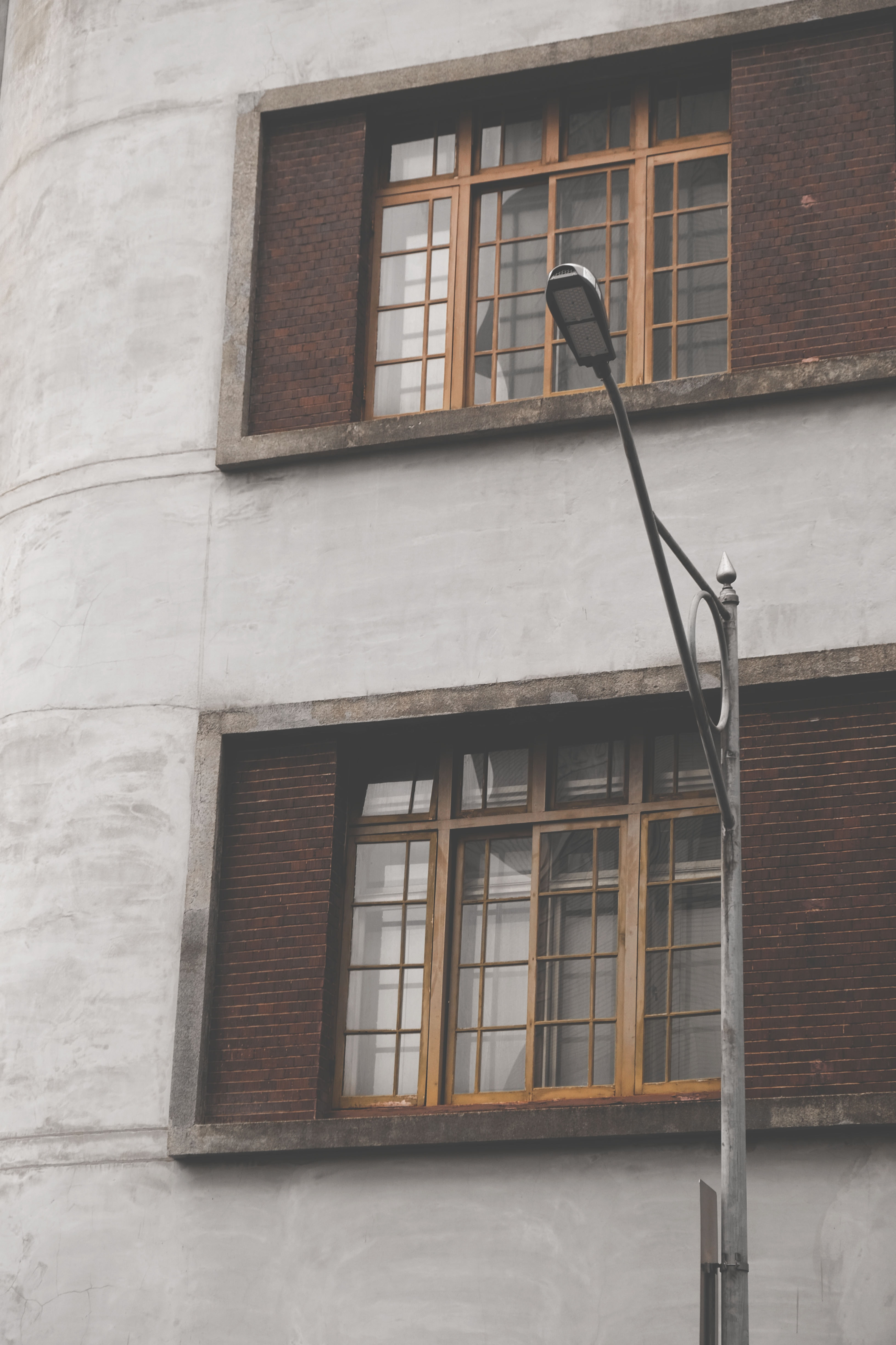 photo of outdoor post lamp near gray concrete building