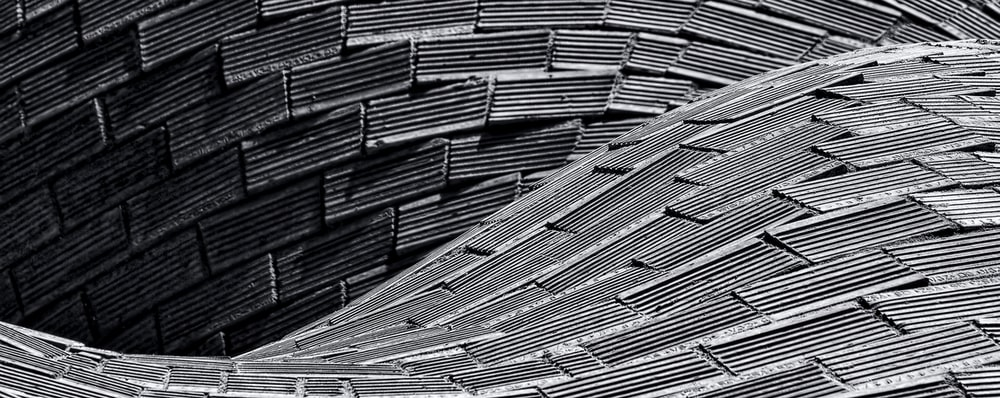 grey tiled curving structure