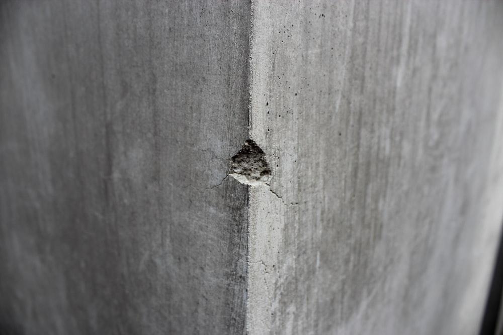 grey concrete pillar showing cracked part