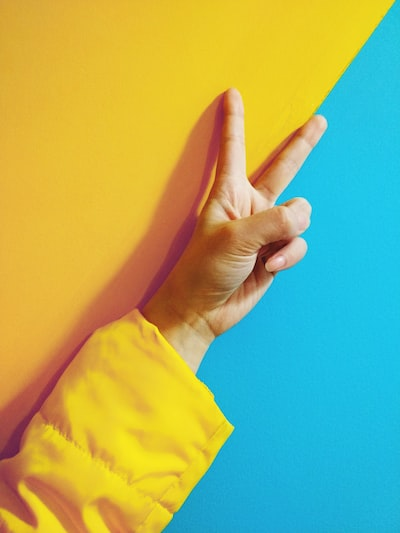 person doing peace hand sign