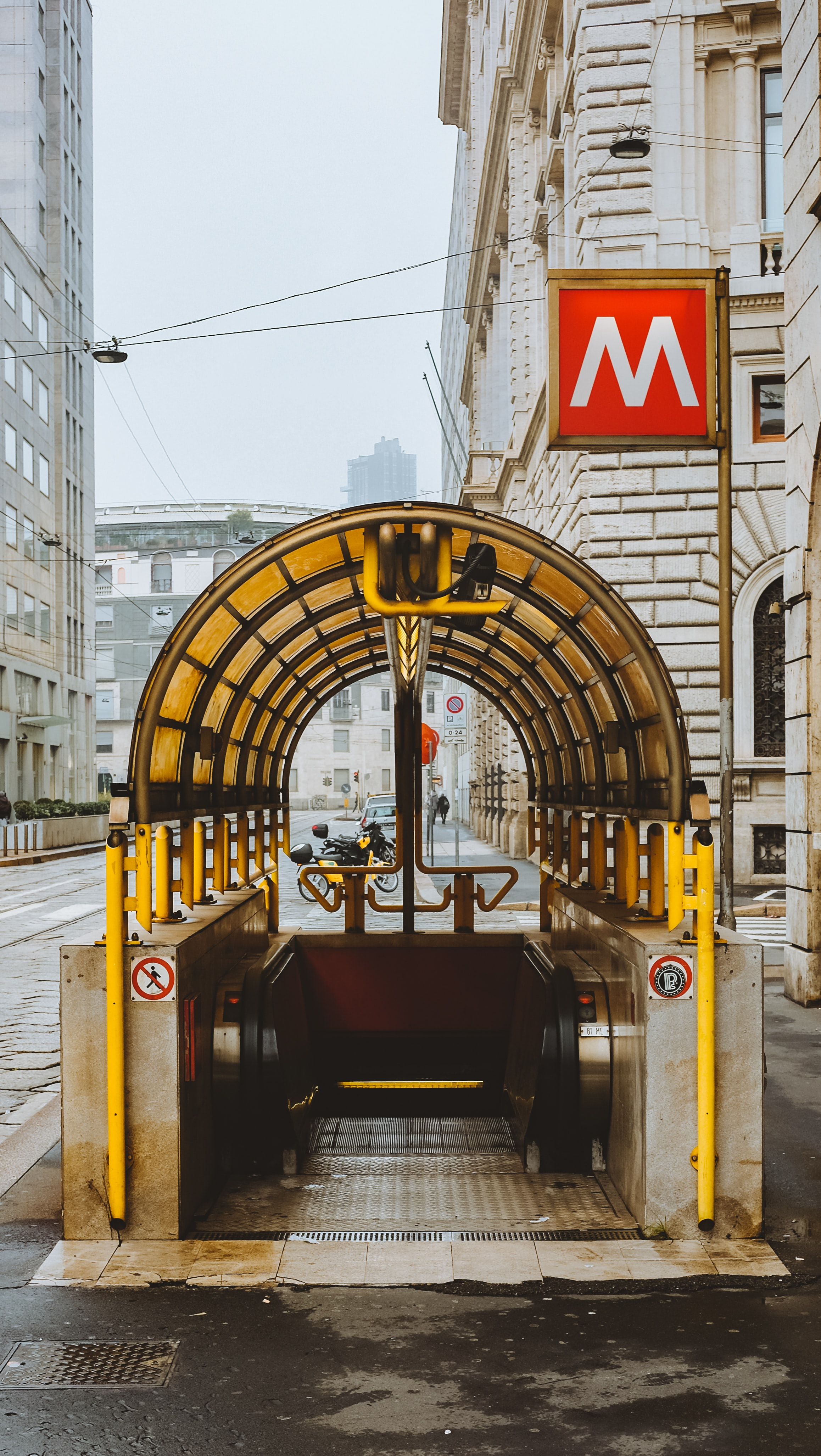 subway station entrance in city during daytime