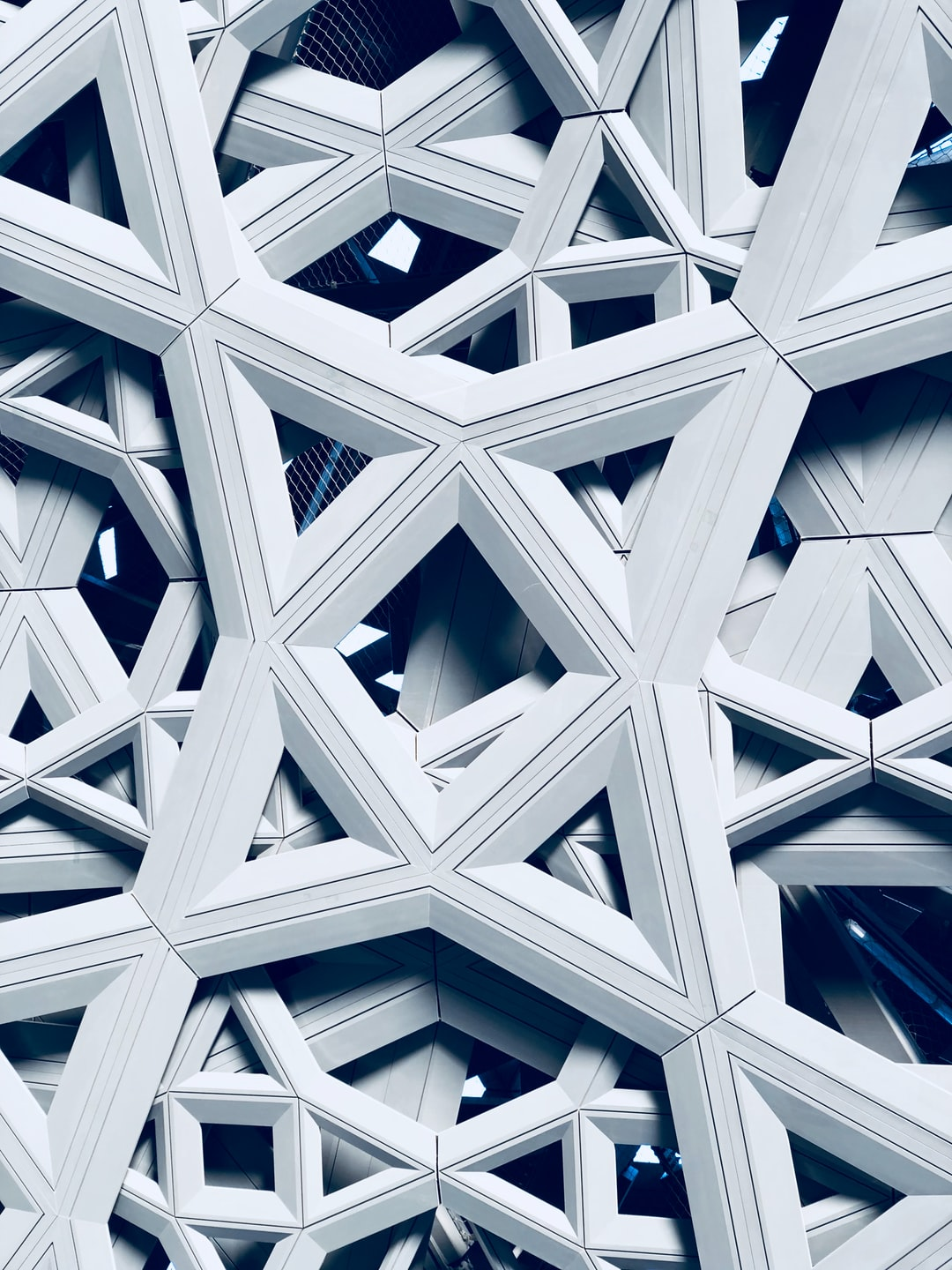 The abstraction of architure of the Abu Dhabi Louvre Museum ceiling it's a piece of art on it's own.