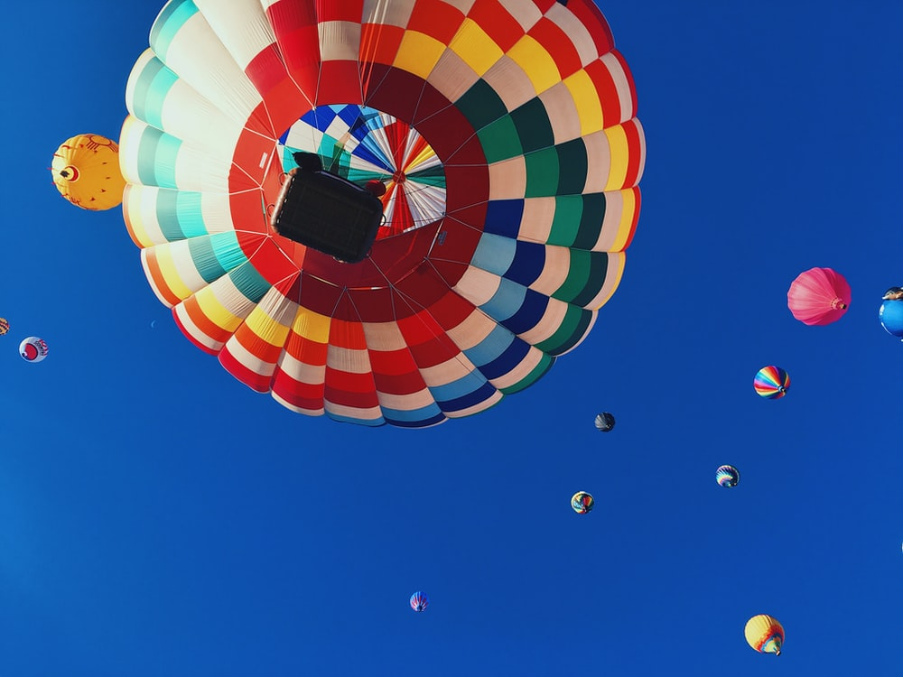 low angle photography of balloons