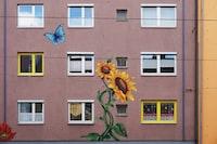 oran ge sunflower paint on building