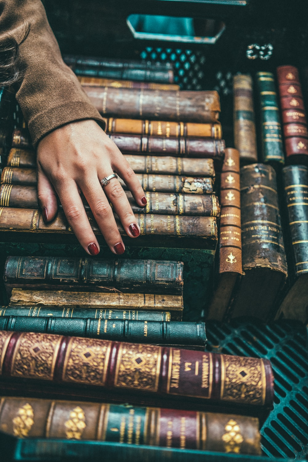 person hand on group of books