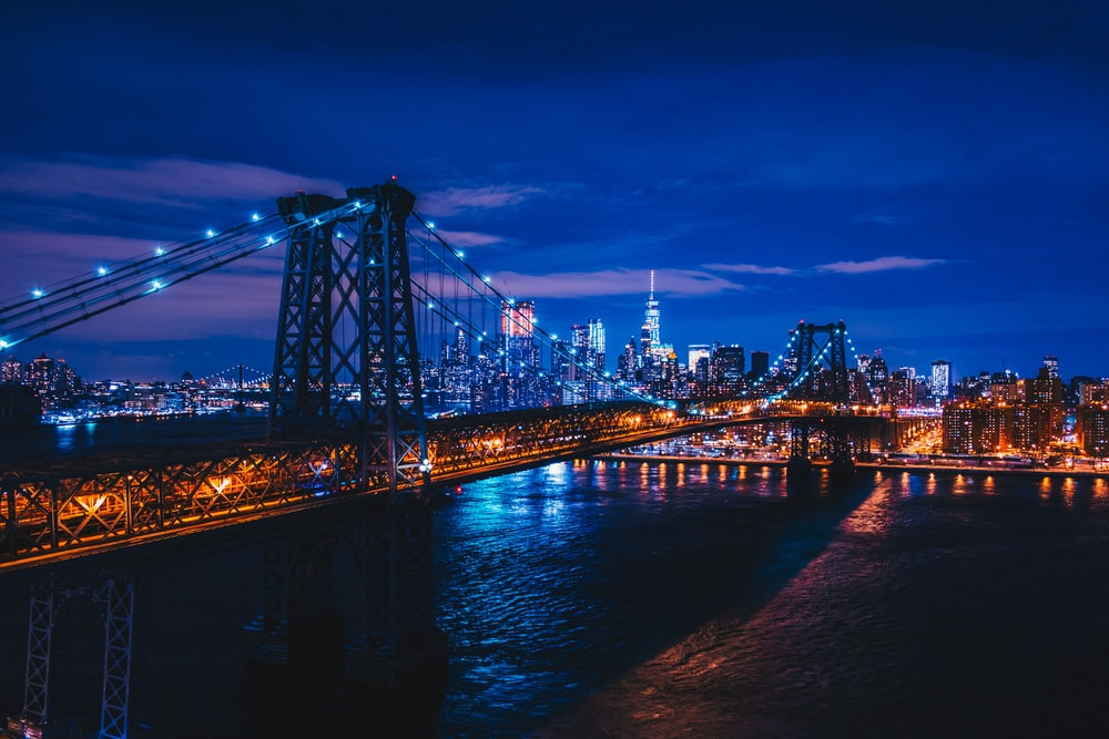 suspension bridge under clear sky during nighttime
