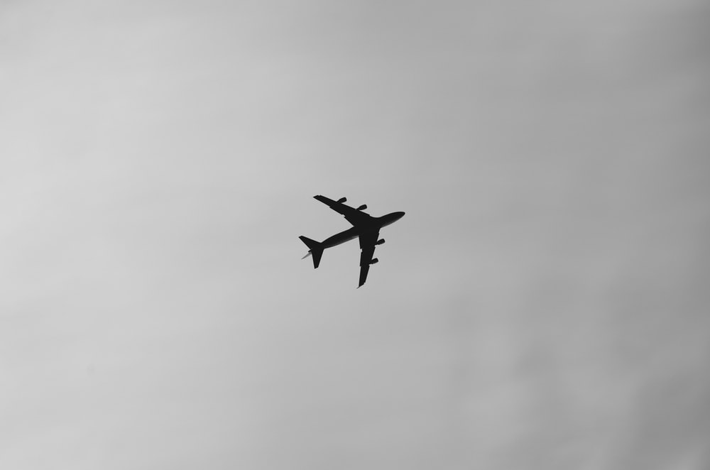 selective focus photography of airplane on air during daytime