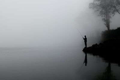 In 2012 I had the honour of travelling to Lombok and climb down into Mount Rinjani active Volcano. Local fisherman love to fish in these lakes and do catch plenty of fish. This fisherman was standing in dense fog trying is luck to catch a couple of fish.