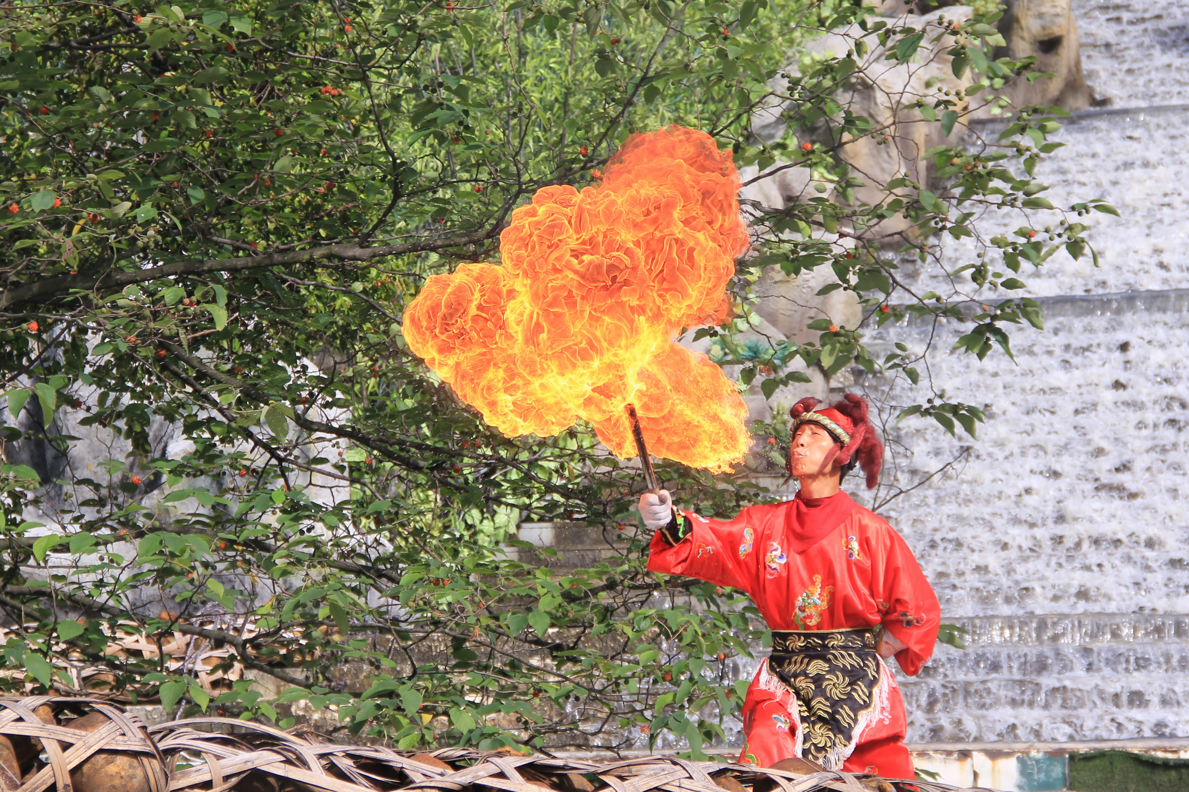 man doing fire activity during daytime