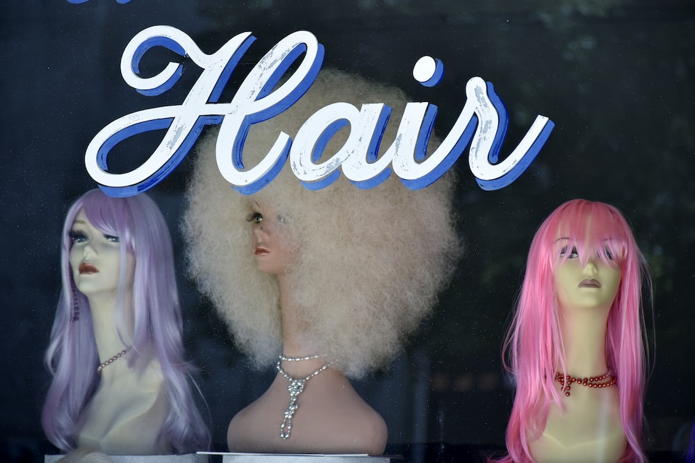 three assorted-color hair wigs