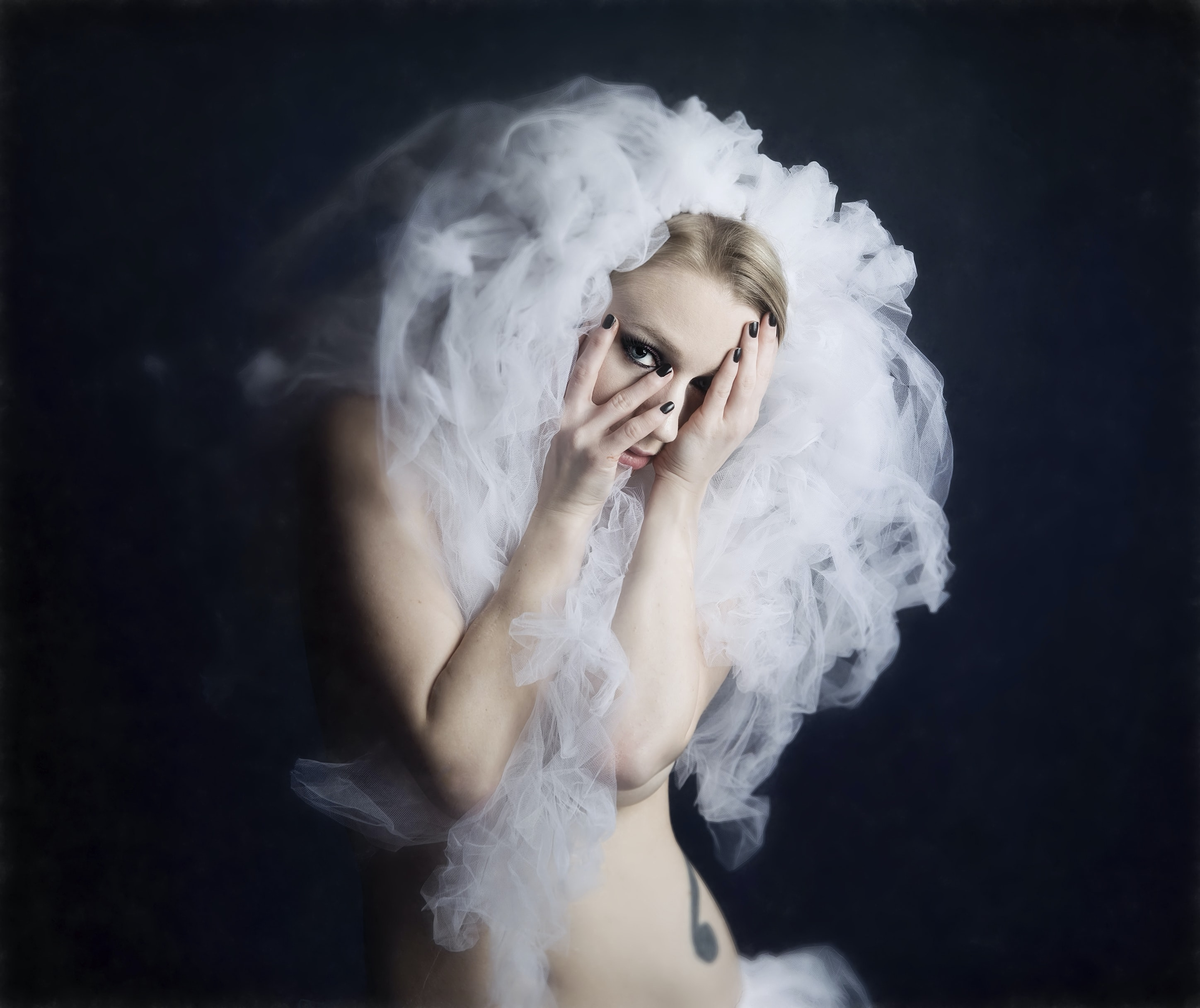 topless woman covered with smoke in black background