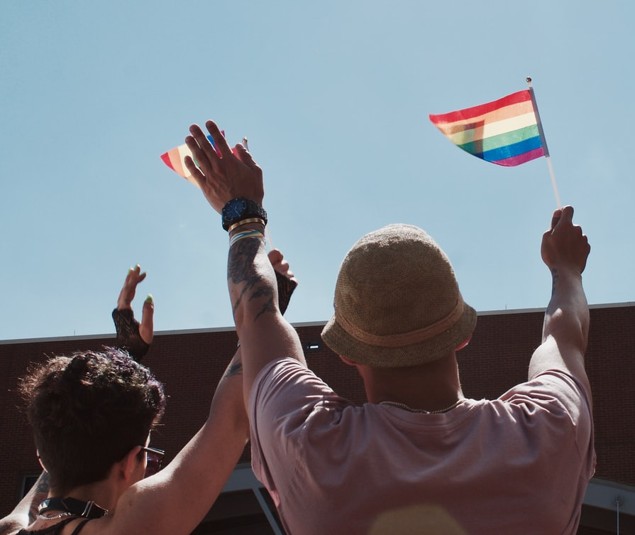 Person waving pride flag