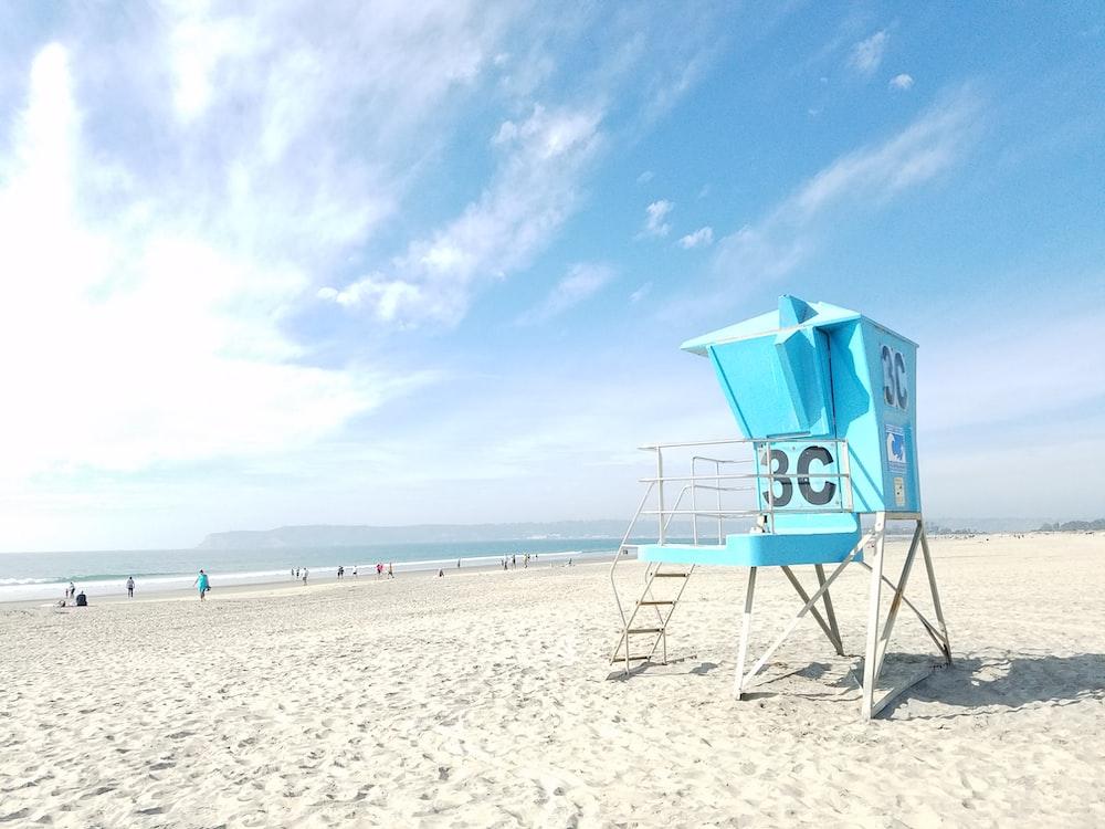 blue lifeguard house near beach shore