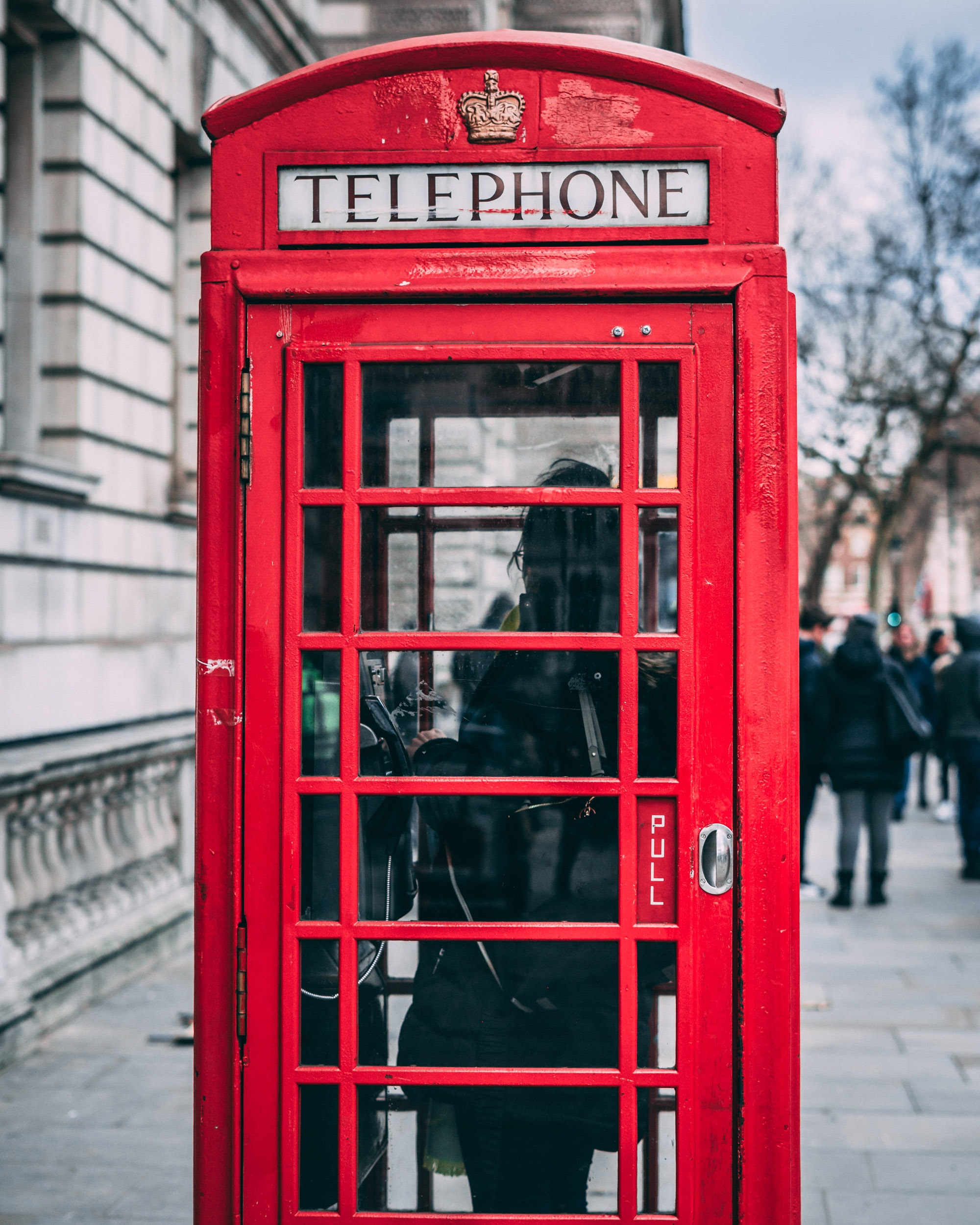 closeup photo of red telephone booth