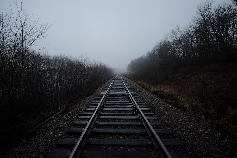 black railway covered with fog