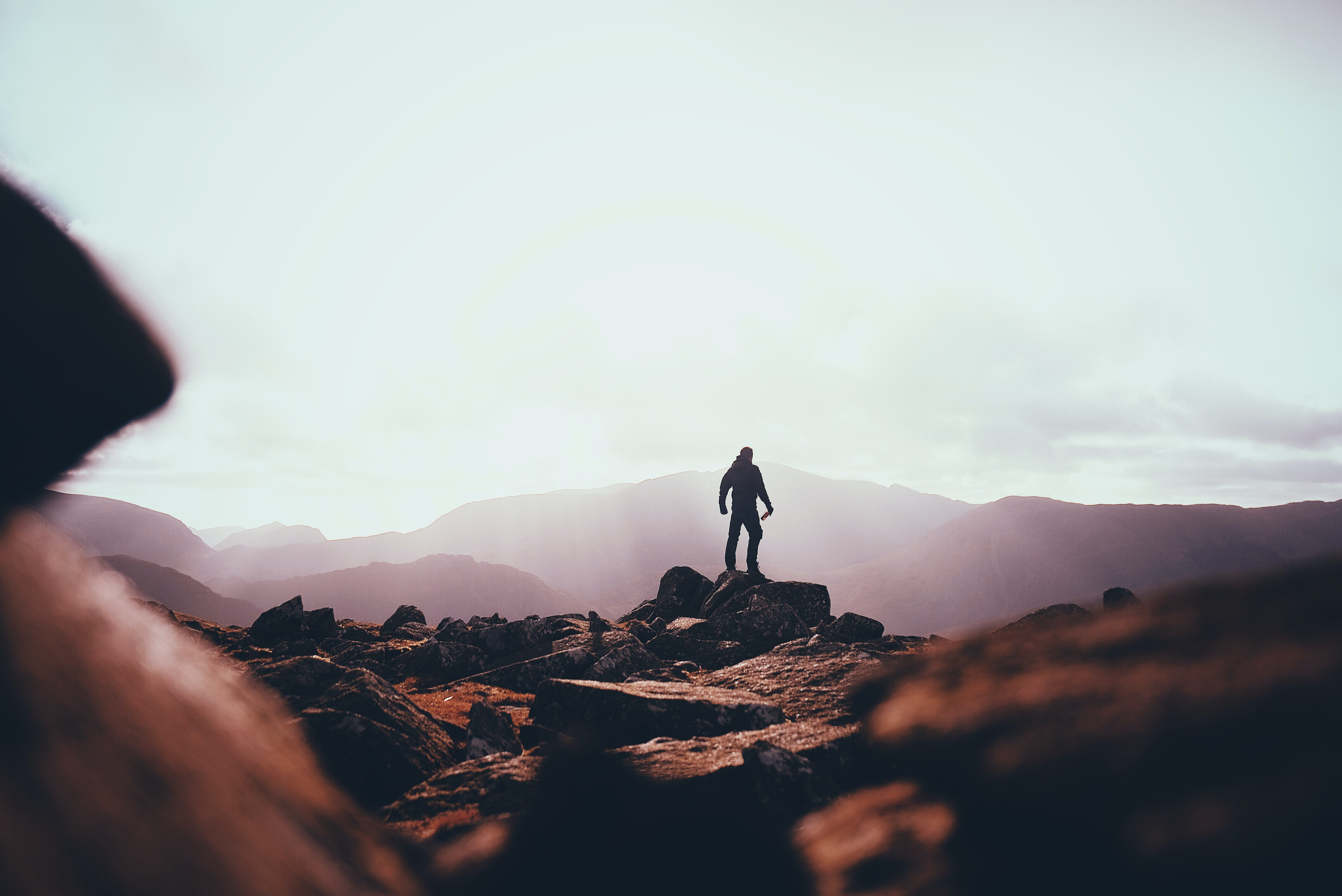 person standing on huge rock