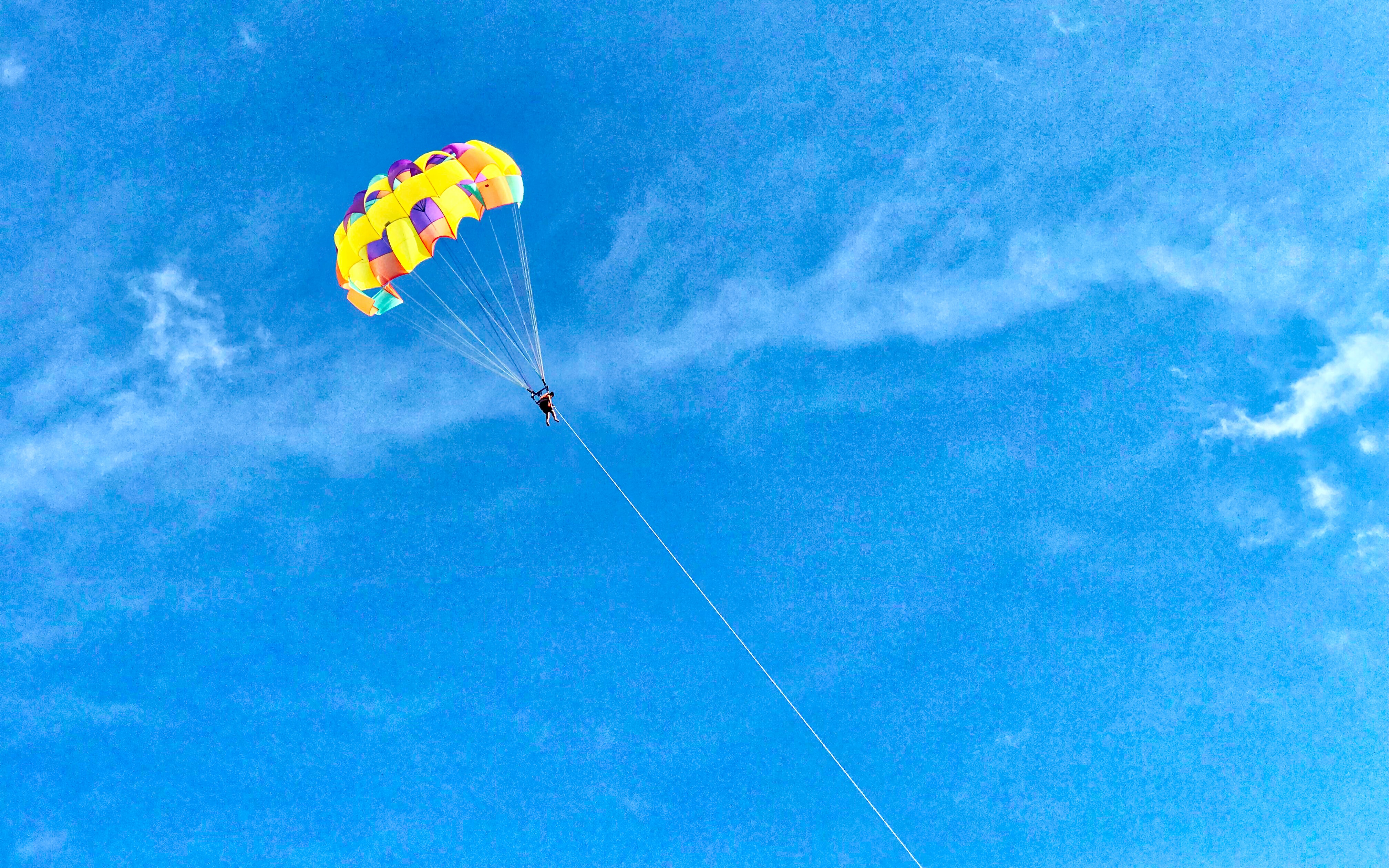 person paragliding outdoors