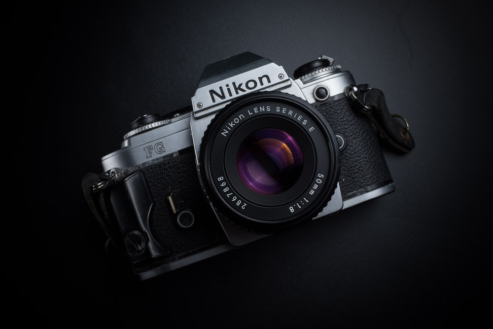 black and gray Nikon camera
