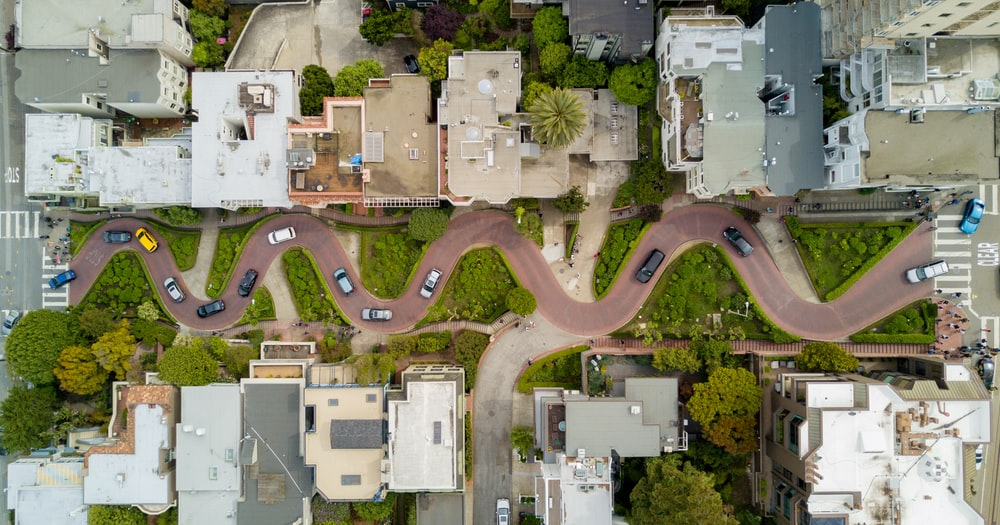 aerial photography of gray concrete houses and brown road
