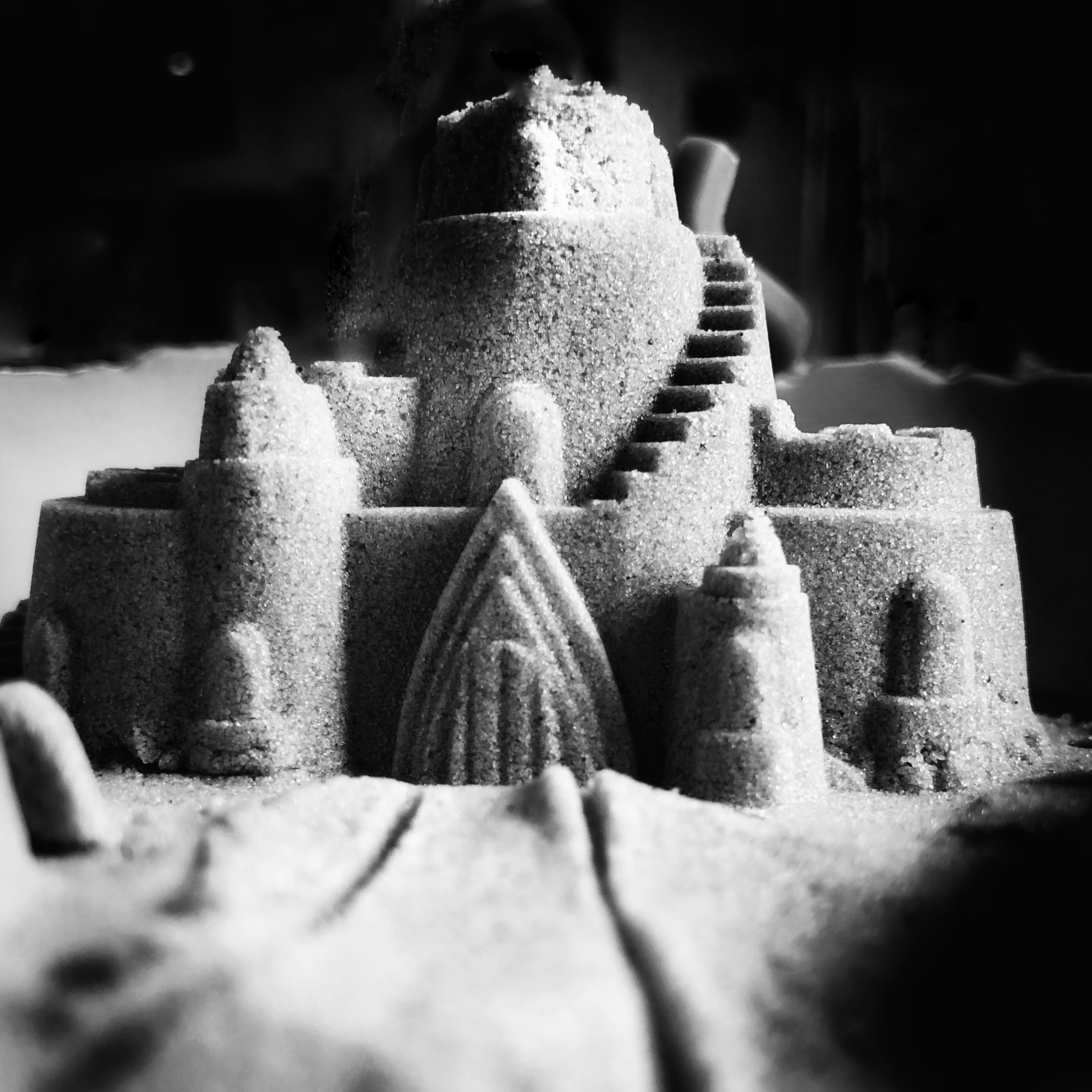 grayscale photo of sand castle