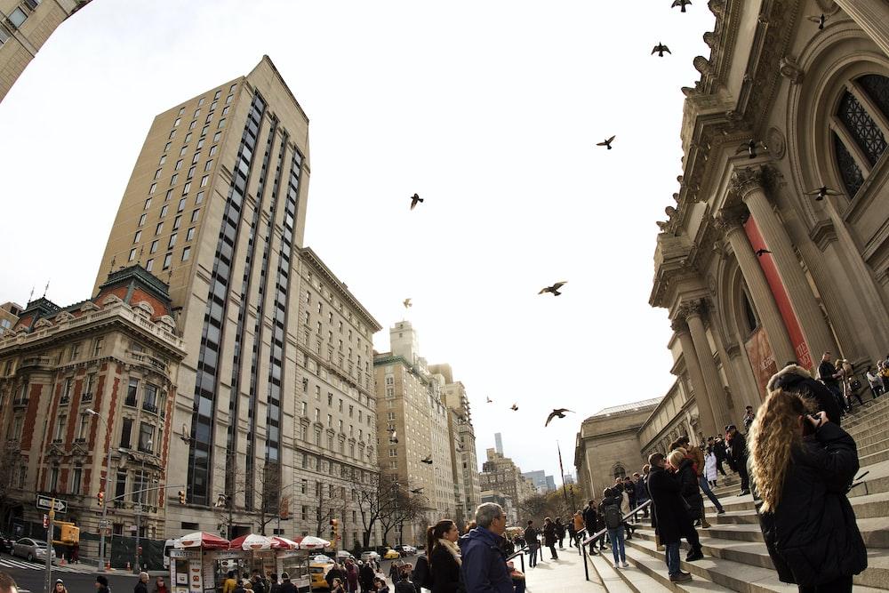 people walking near concrete building during daytime