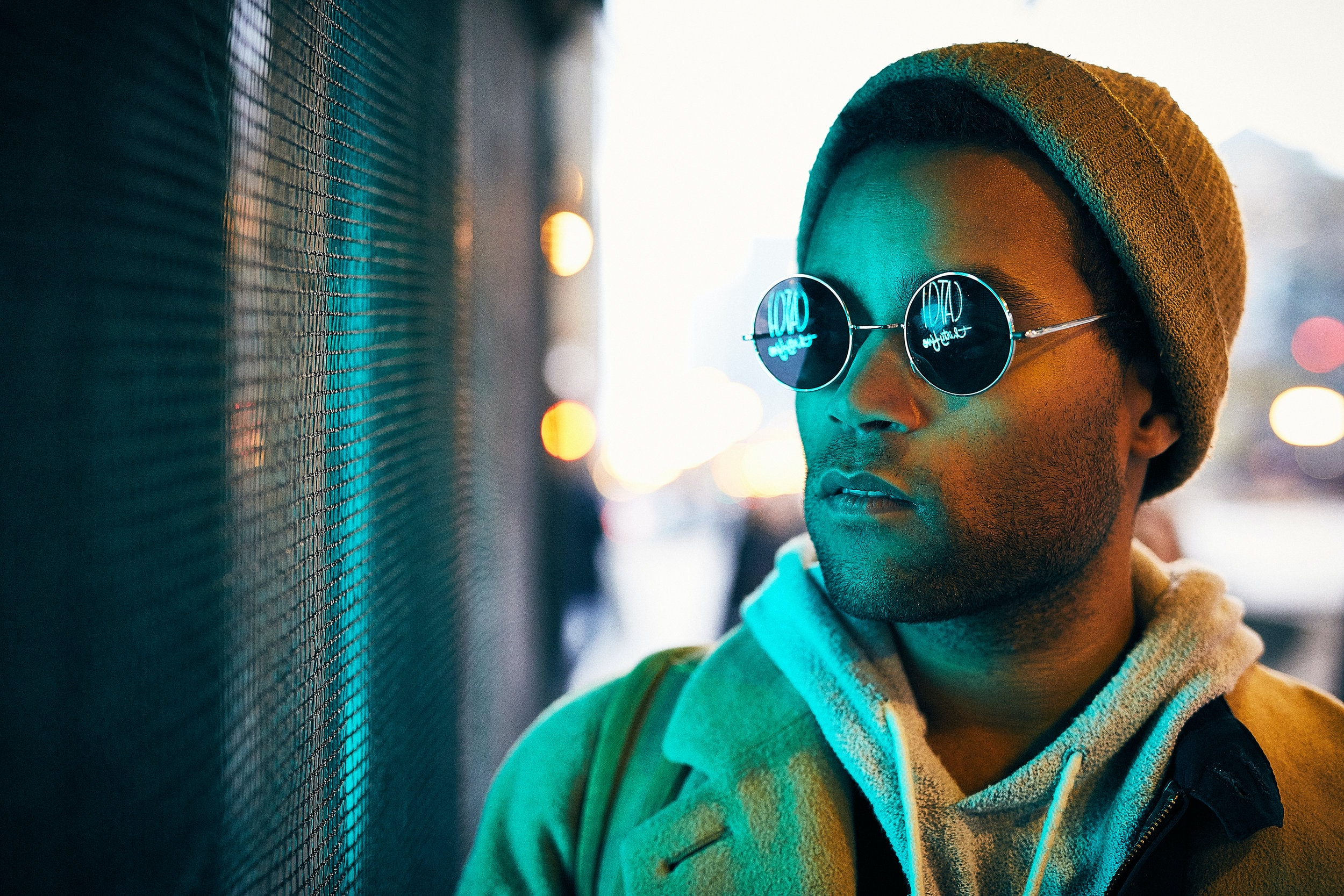 man wearing sunglasses looking at window