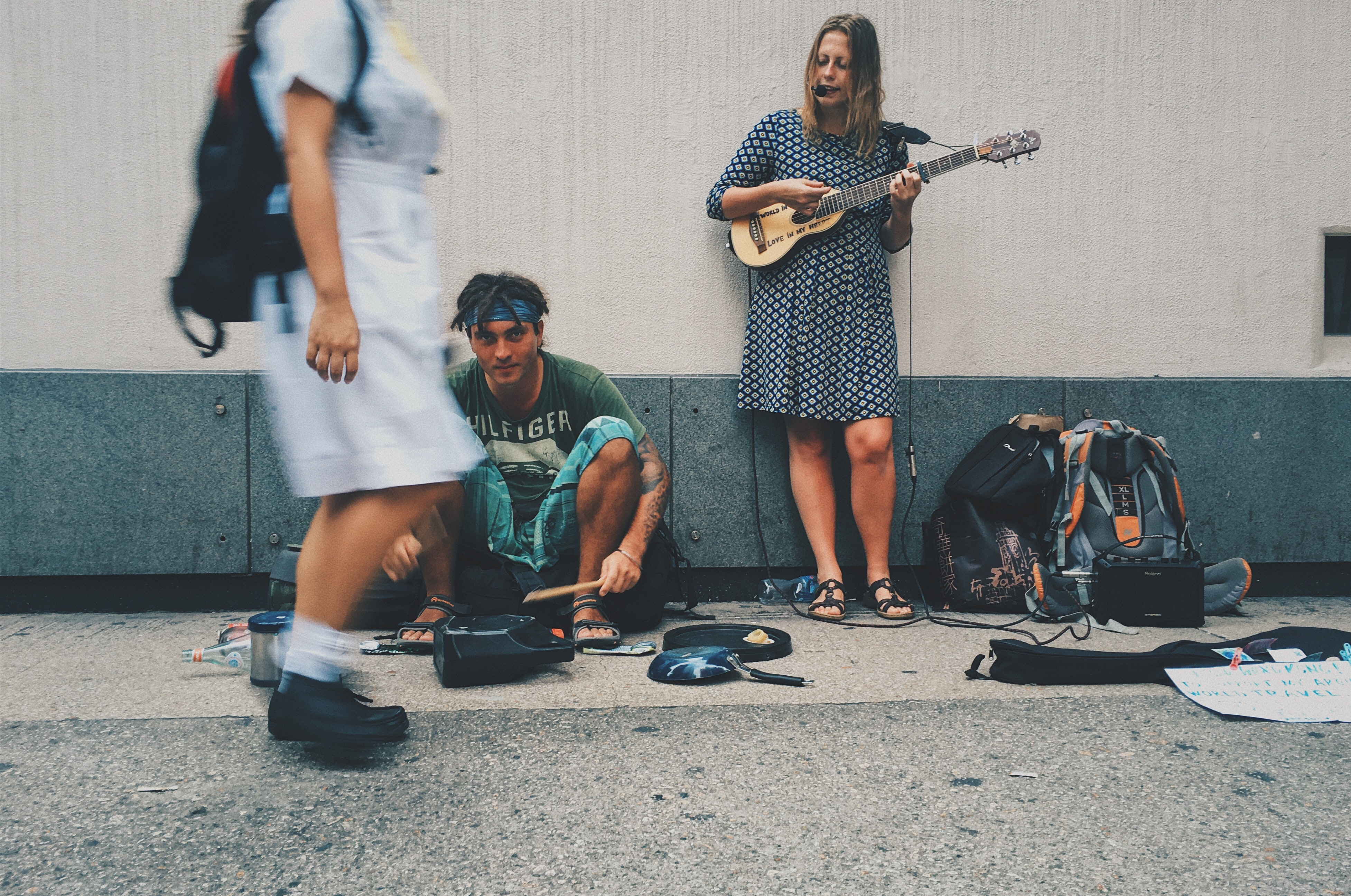woman playing guitar on street