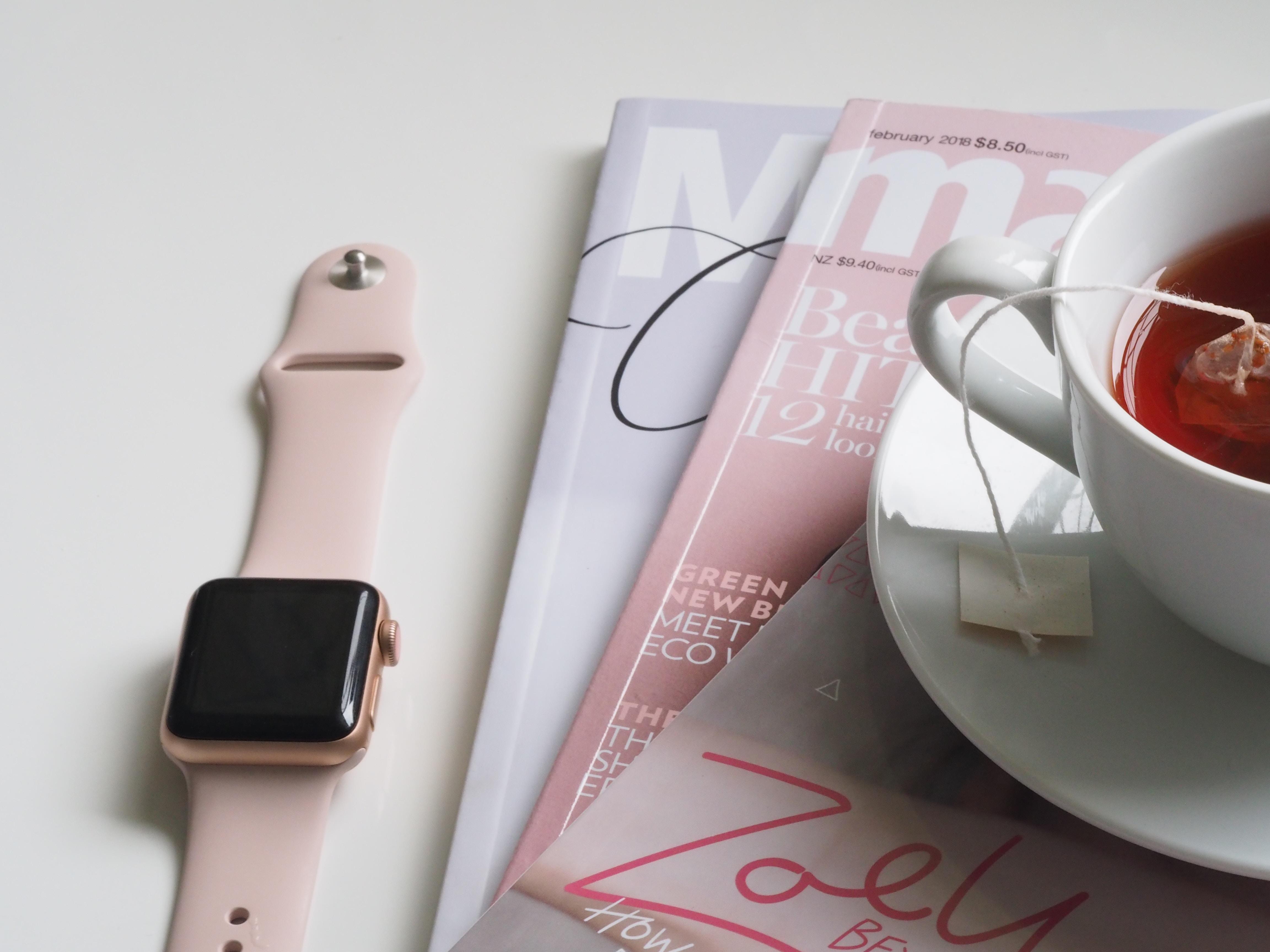 smartwatch near three books