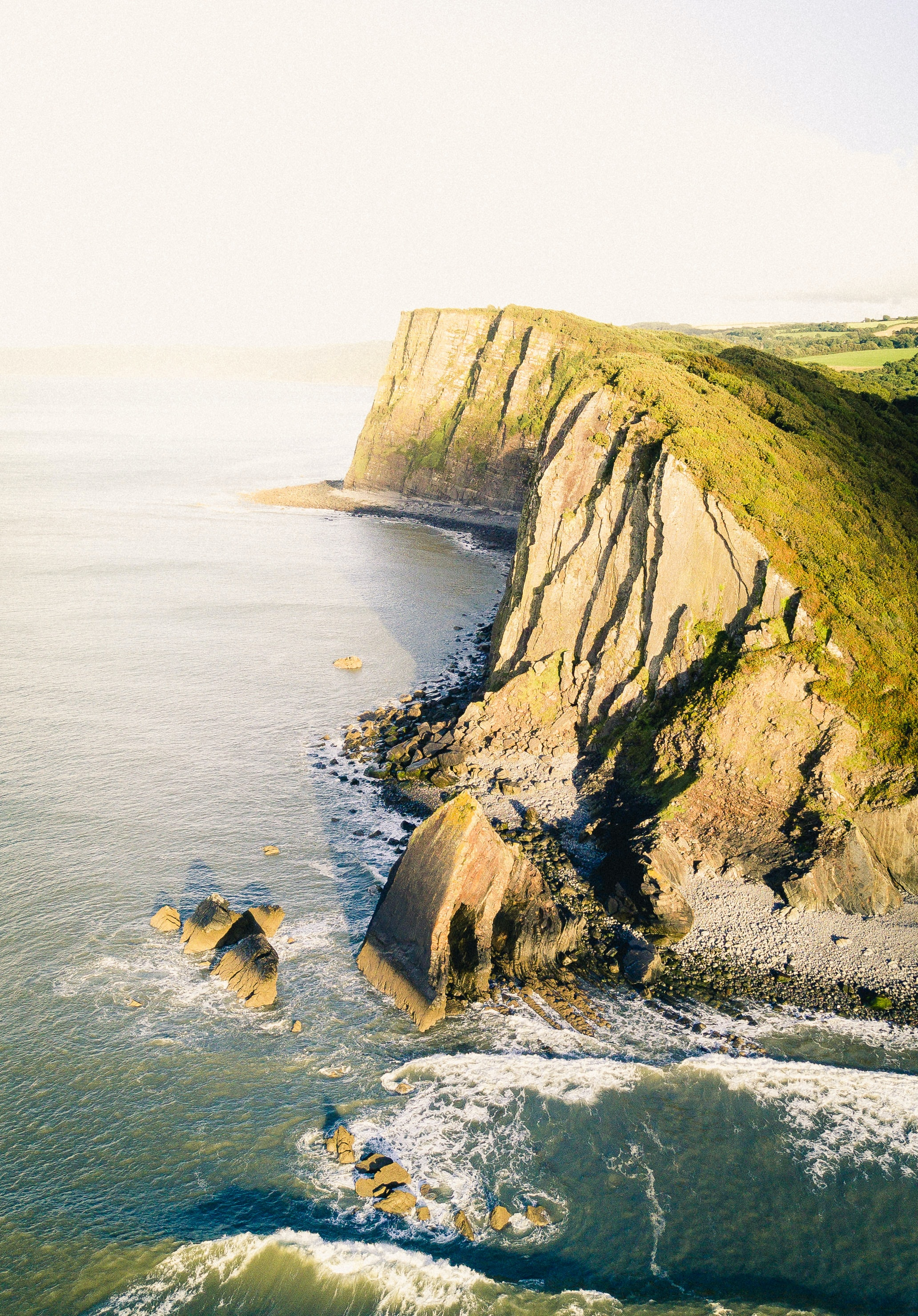 aerial shot of cliff near body of water