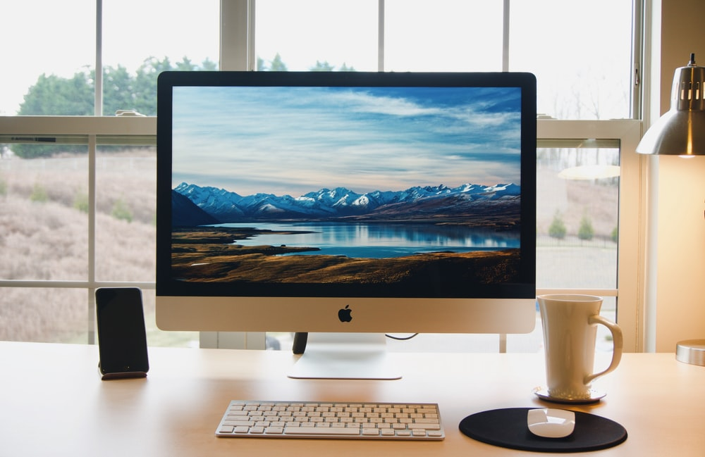 silver iMac ad wireless keyboard