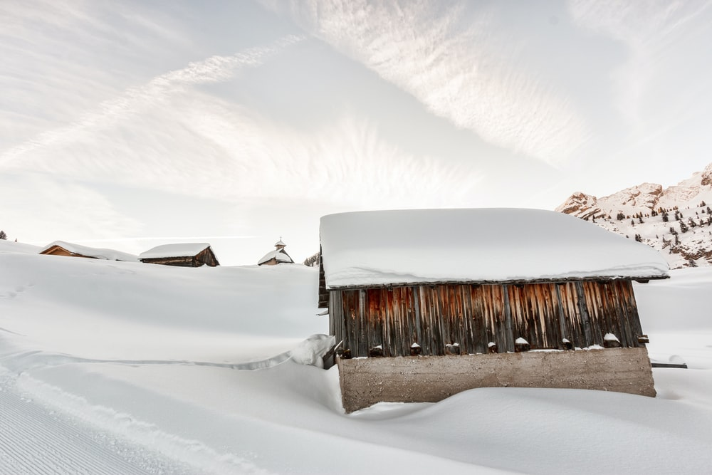 photo of shed covered with snow