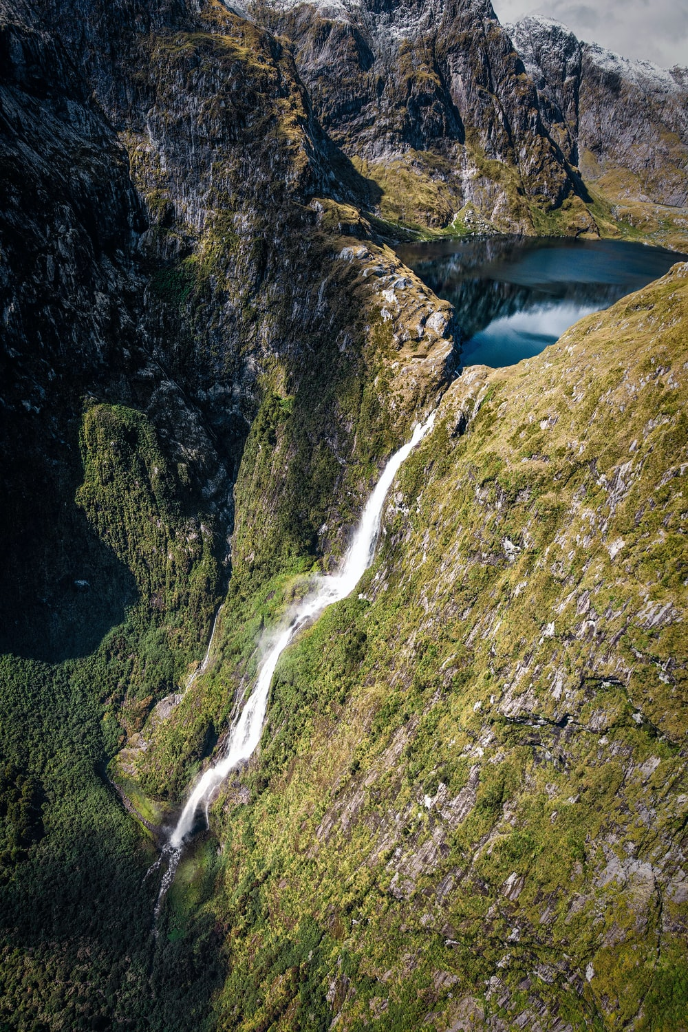 top view of lake with waterfalls