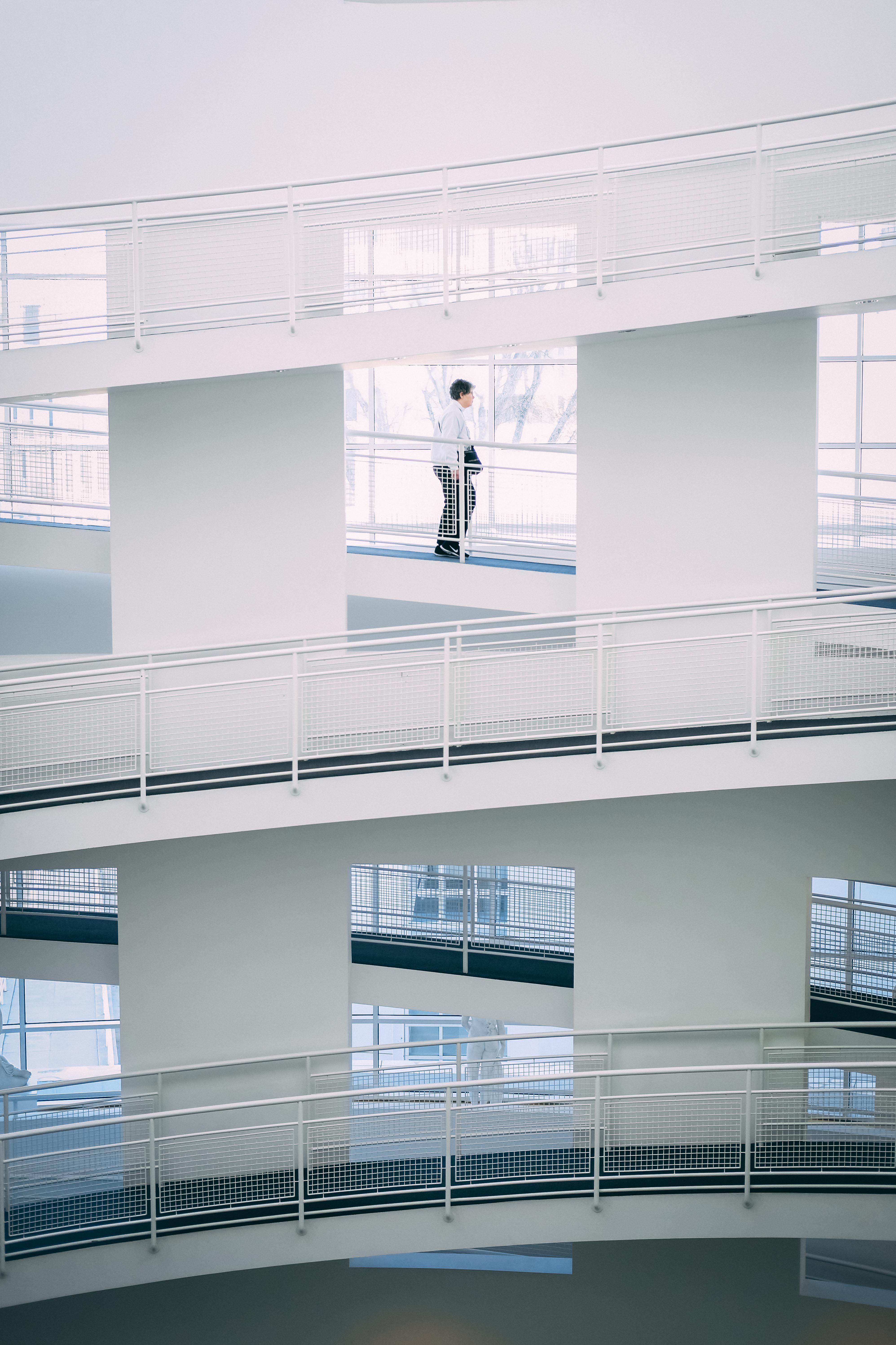 person walking on stairs inside building during daytime
