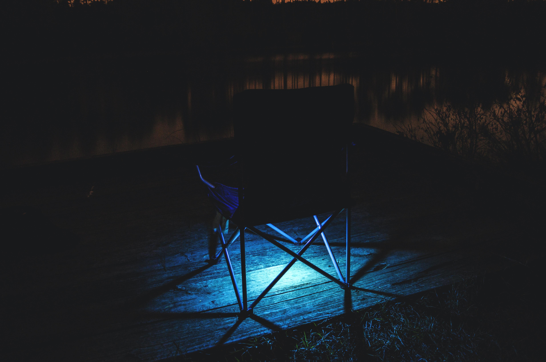 black chair on brown parquet flooring