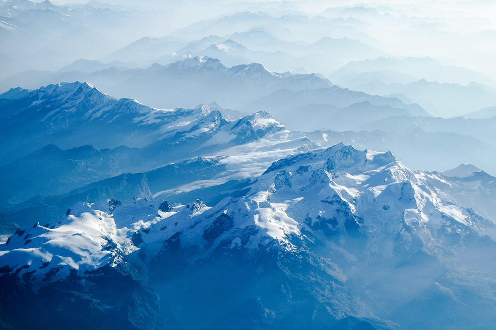 snow capped mountains at daytime