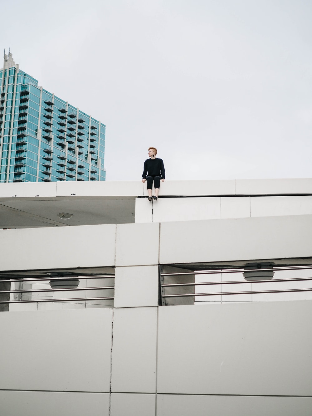 man sitting on top of roof deck