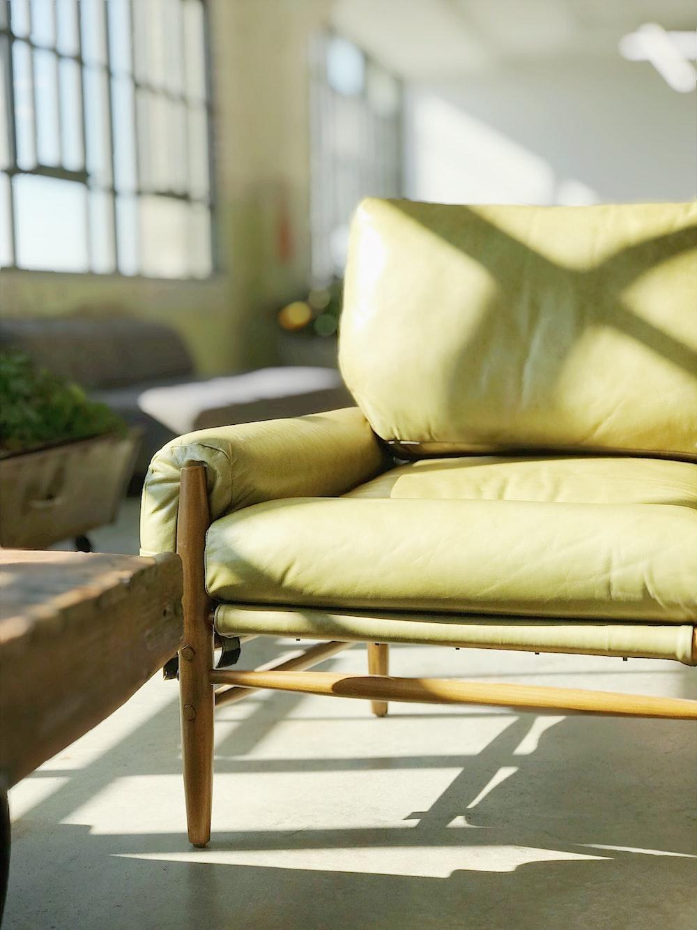 yellow leather sofa near window