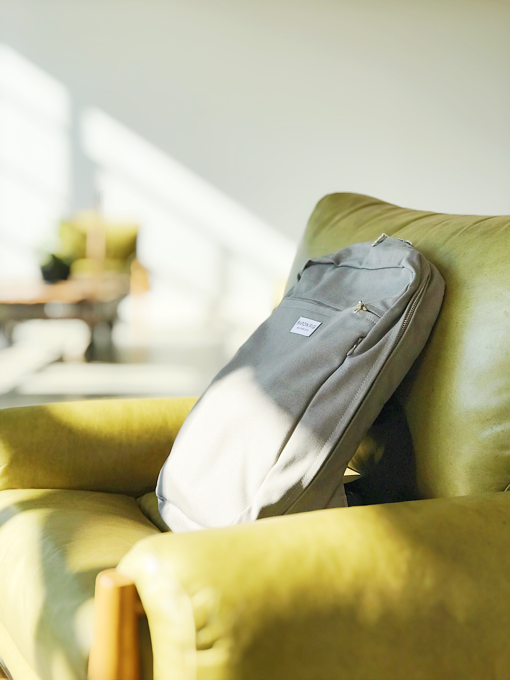 grey bag on sofa