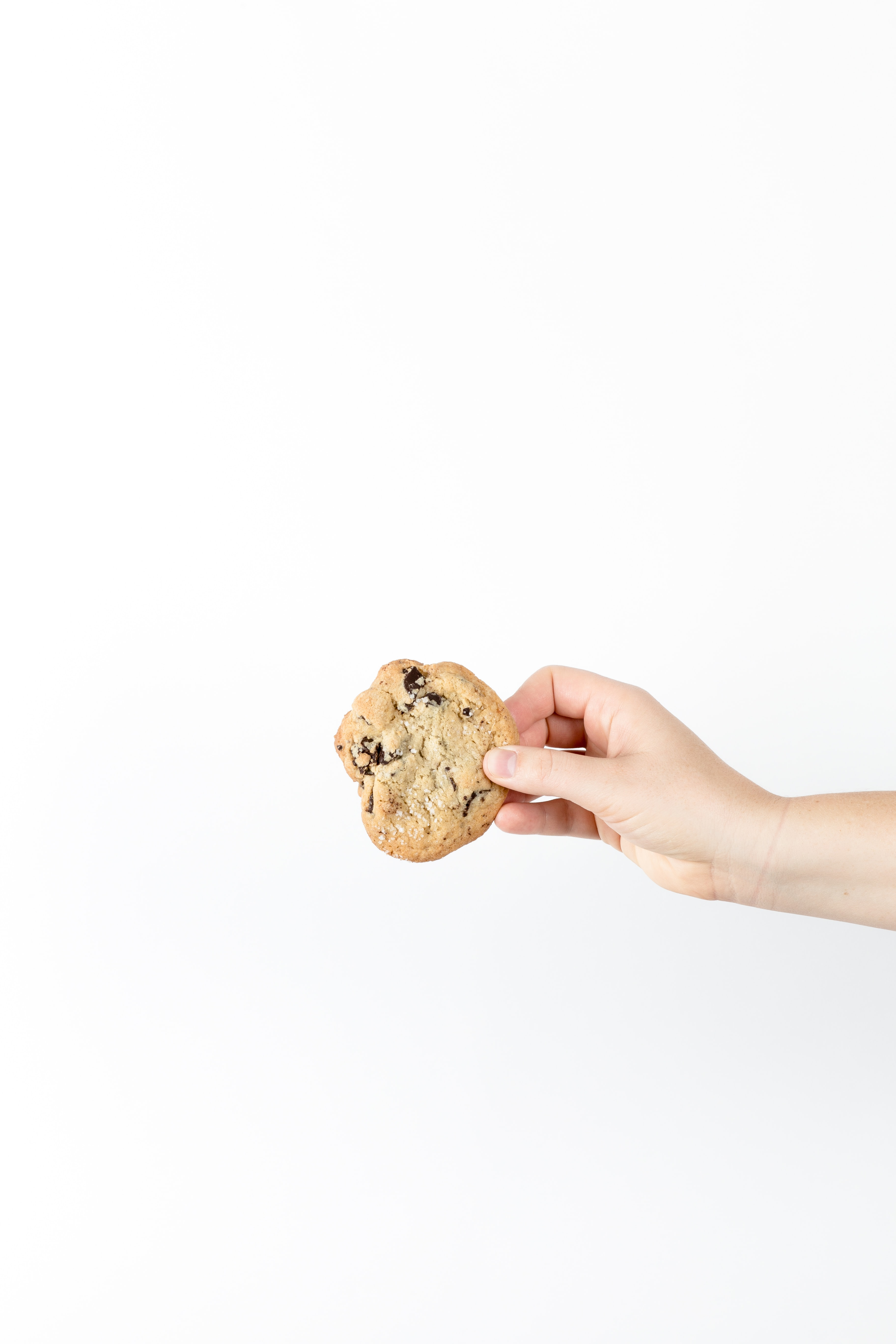 person holding cookies