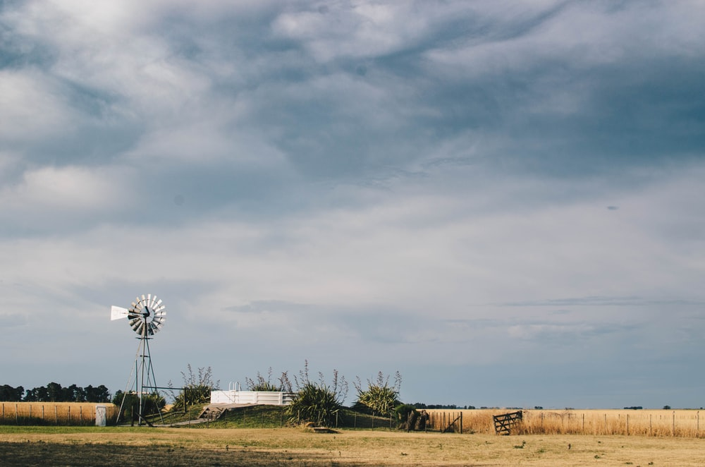 white windmill on farm