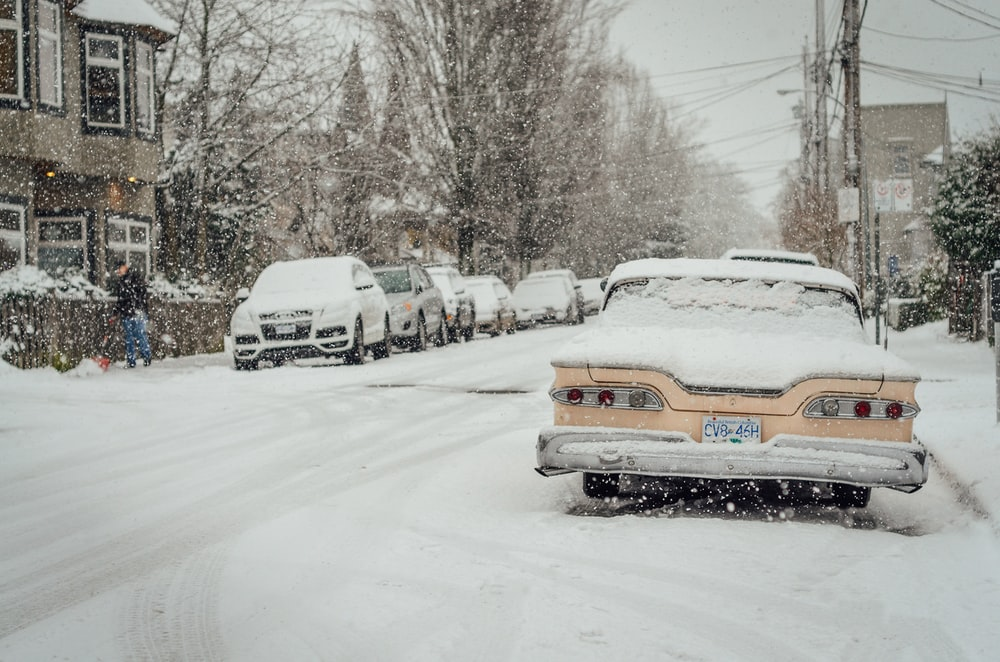 cars covered with snow outdoors